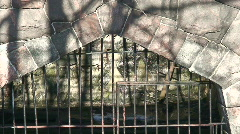 Stone cage in a Zoo two, zoom-out Stock Footage