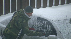 Man is scraping the frost off his car (High Definition) - stock footage