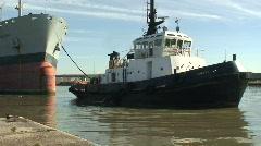 Tug pulling tanker HD 1080i Stock Footage