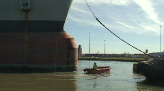 Tugmen and large tanker HD 1080i Stock Footage