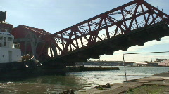 Road bridge being raised to allow ship to enter dock Stock Footage