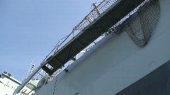 Looking up at a tanker coming into dock. HD 1080i Stock Footage