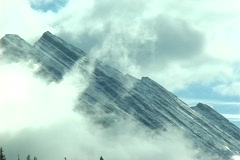 Alberta Mountain Peak and Clouds Stock Footage