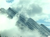Stock Video Footage of Alberta Mountain Peak and Clouds