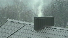 Smoke coming from chimney on a rainy day two Stock Footage