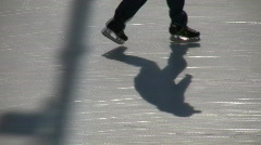Stock Video Footage of Closeup of an ice skater's feet (High Definition)