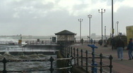 Walking on the promenade in a storm. HD 1080i Stock Footage
