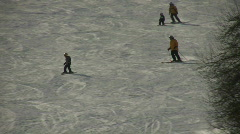 Father and son are skiing down a hill (High Definition) Stock Footage