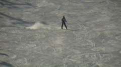 Winter scenic of girl skiing down a hill (High Definition) Stock Footage