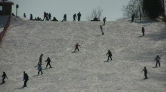 Winter scenic of people skiing down a hill (High Definition) Stock Footage
