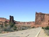 Arches National Park minivan driving toward Stock Footage