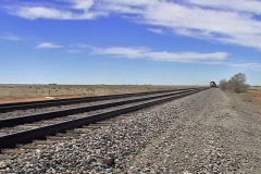 Train approaching in desert Stock Footage
