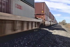 Train passing by in desert Stock Footage