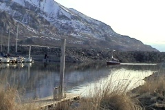 Sailboat motoring in harbor - stock footage