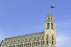 Emily Morgan Hotel with Texas Flag Stock Footage