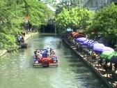 San Antonio Riverwalk barge going away Stock Footage