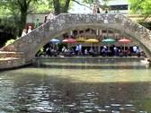 San Antonio Riverwalk two barges under bridge Stock Footage