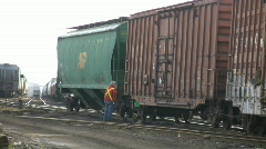 Railway worker unhitching a freight car (High Definition) Stock Footage