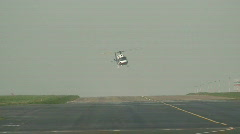 Helicopter taxiing over runway. HD 1080i Stock Footage