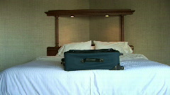 Suitcase Luggage on Bed in Hotel Room Stock Footage