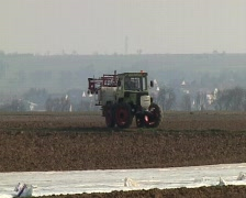 Tractor with folded spraying arms Stock Footage