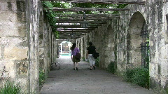 Alamo arch walk two ladies HD Stock Footage