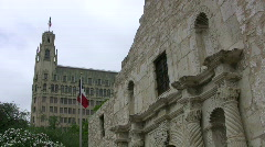 Alamo facade Emily Morgan Texas Flag HD Stock Footage