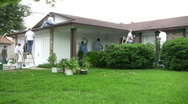 Neighbors painting house church volunteers HD Stock Footage