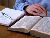 Bible Study - Taking Notes Stock Footage