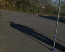 Woman walking with crutches Stock Footage