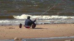 Stock Video Footage of Kite and tricycle near the sea three