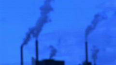 Blurred Factory Smoke Stacks Toned Blue - Environmental Pollution Stock Footage