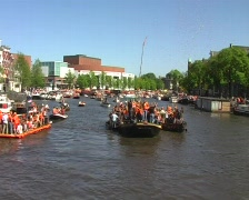 Orange crowd on a boat at queensday in Amsterdam Stock Footage