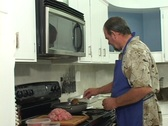 Stock Video Footage of Man in an apron cooking