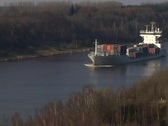 Freight ship in a channel Stock Footage