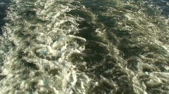 Water stream two behind cruise ship Stock Footage