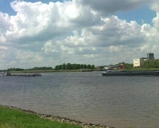 Cargo ships on the river Waal Stock Footage
