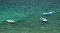 Three empty dive boats in shallow water in the Philippines Stock Footage