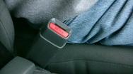 Fastening a Seatbelt Stock Footage