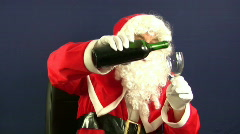 Santa pours a drink Stock Footage