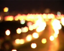 Night traffic into focus x2 Stock Footage