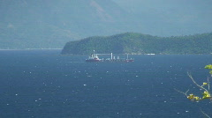 Cargo ship on the ocean in the Philippines Stock Footage
