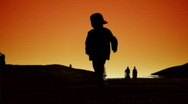 Kid walking in sunset Stock Footage