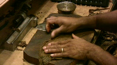 Cigar making closeup hands HD - stock footage