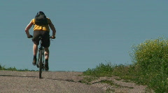 Bicyclist driving uphill Stock Footage