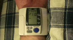 Ending blood pressure measurements with portable b Stock Footage