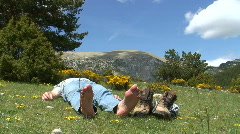 Hiker resting in a meadow Stock Footage