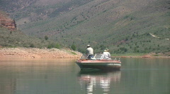 Mountain Lake fishing boat zoom out HD Stock Footage