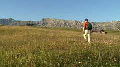 Hiking in a mountain meadow Stock Footage