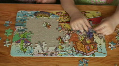 Time-lapse of solving the jigsaw puzzle Stock Footage
